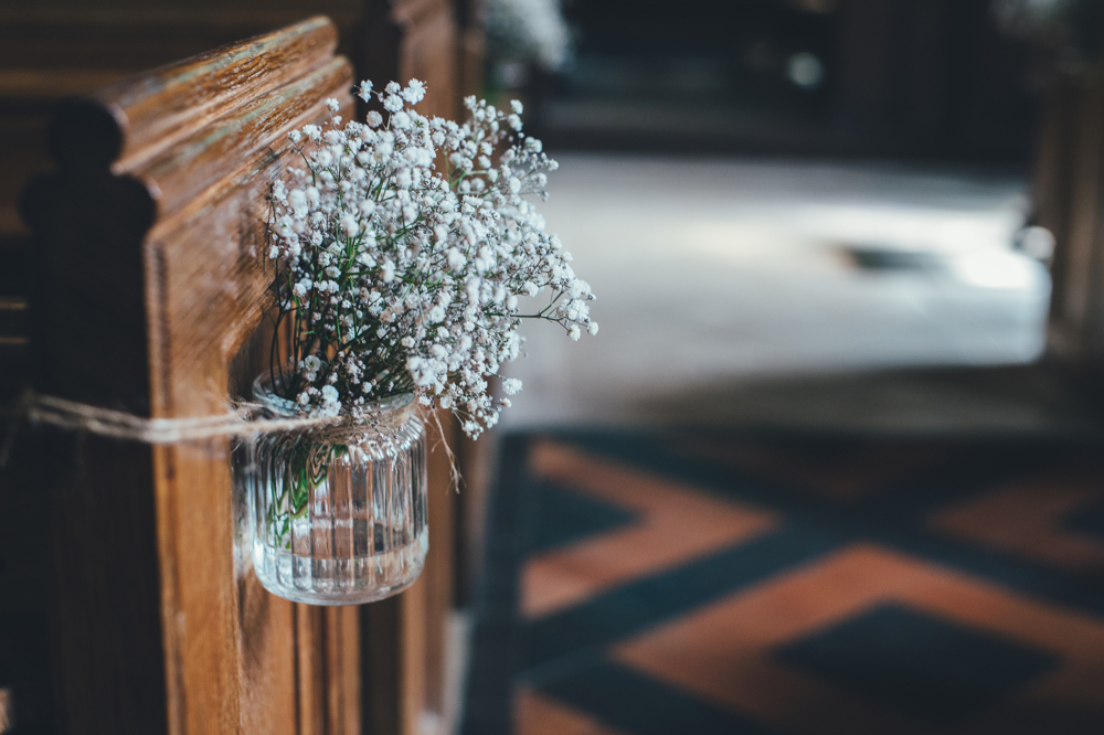 Pretty Flowers On A Pew